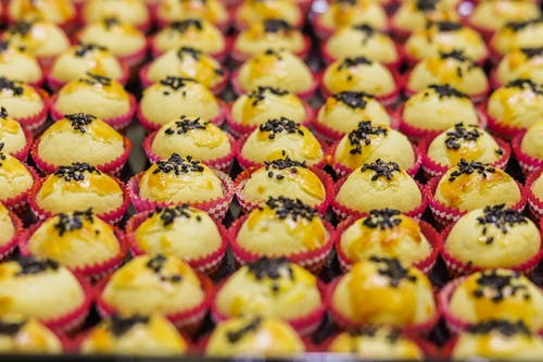 Close Up Photo of Cupcakes with Black Sesame Seeds on Top