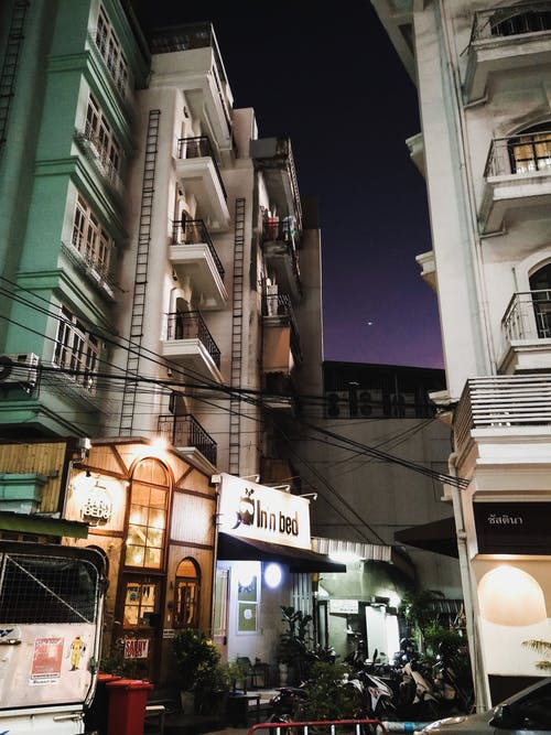 Free stock photo of apartment building, city night, hotel