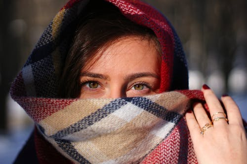 Woman Covering Her Face With Scarf