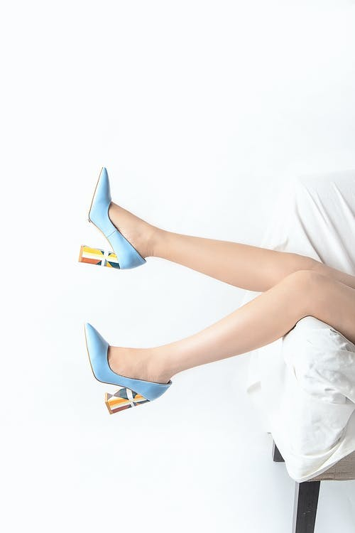 Woman in Blue and White Peep Toe Stiletto Shoes