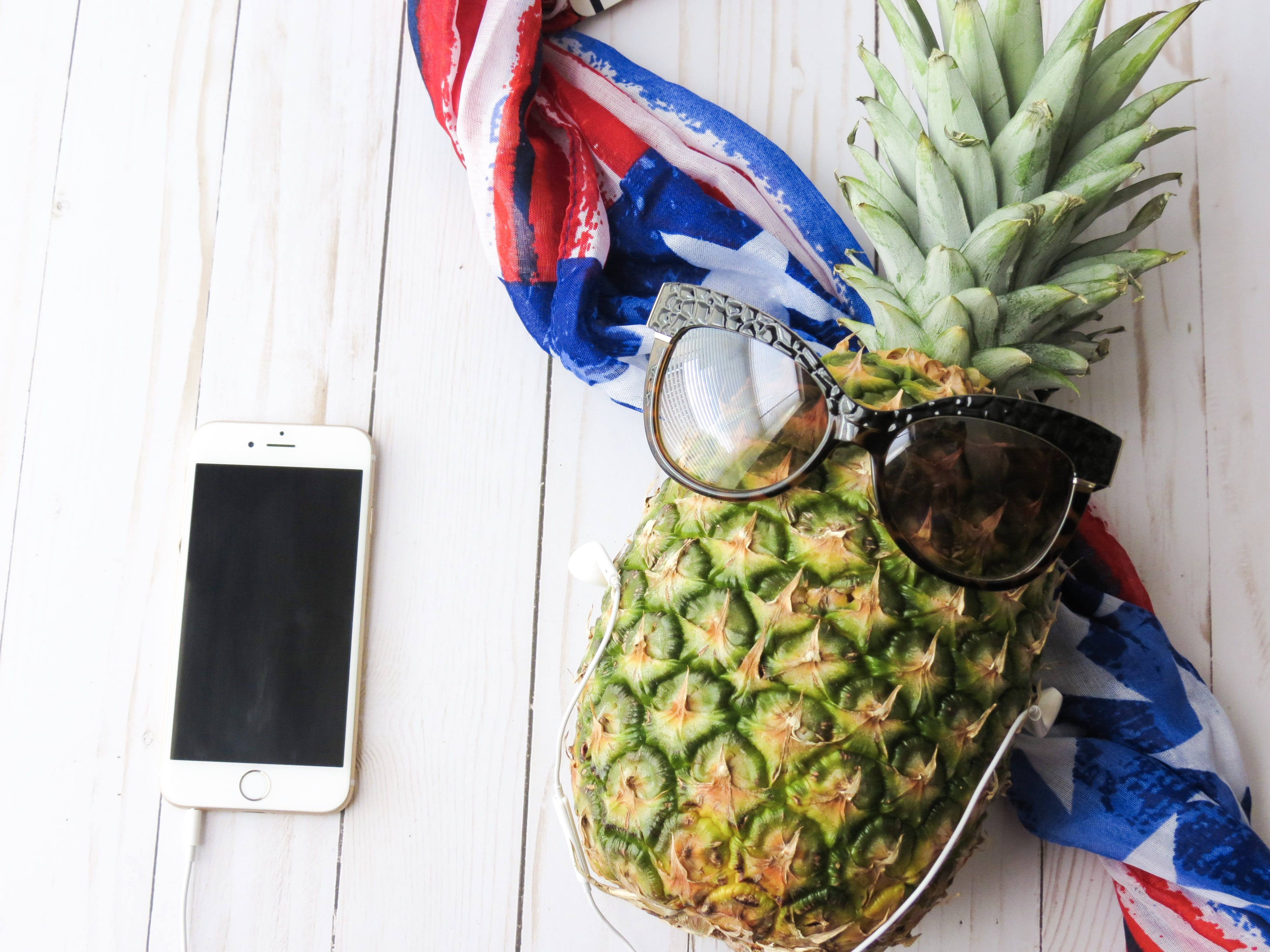 Ripe Pineapple With Brown Sunglasses Near Gold Iphone 6 on White Surface