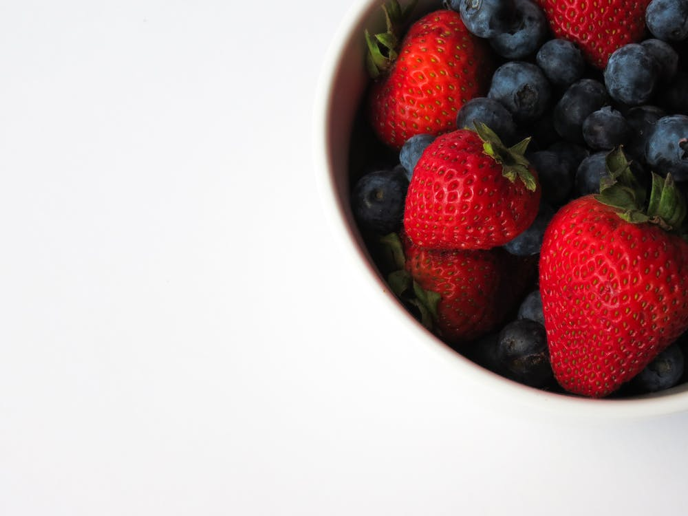 Strawberries and Blueberries on Cup
