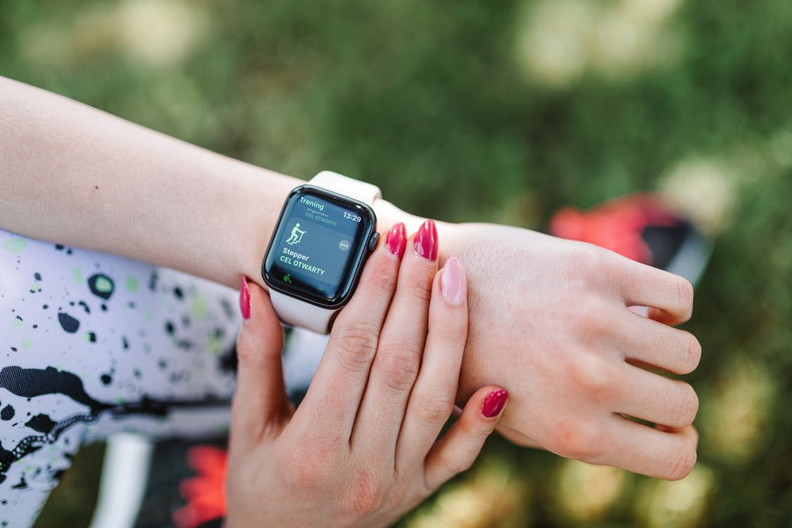 Person Wearing White Sports Band Apple Watch