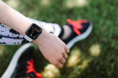 Close-Up Photo of a Person Wearing an Apple Watch