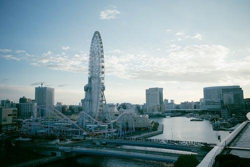White Ferris Wheel Near City Buildings