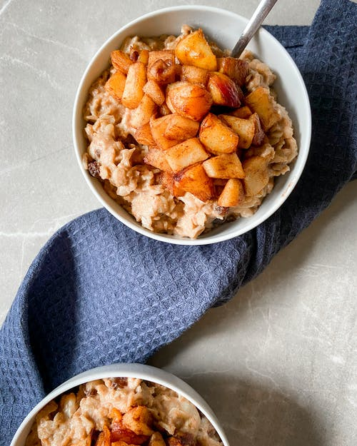 A Bowl of Oatmeal with Apples on Top