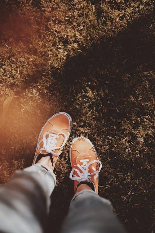 High Angle Shot of a Feet Wearing Orange Footwear