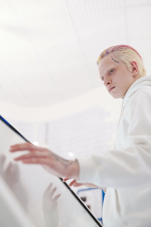 Boy in White Dress Shirt Holding Blue Pen