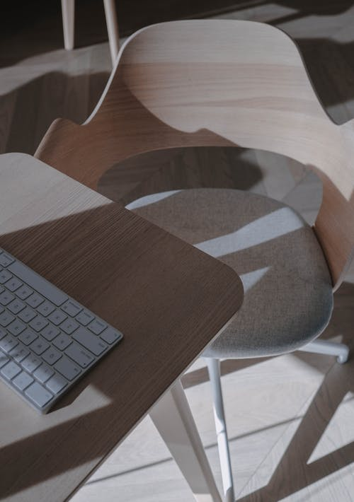 Apple Magic Keyboard on Brown Wooden Table