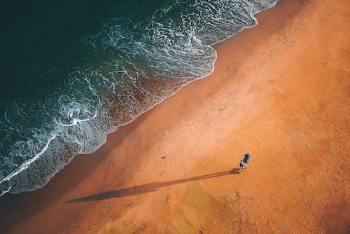 Sandy seashore of ocean with turquoise water
