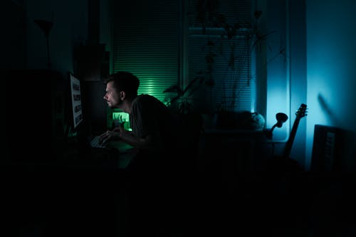 Man working at night at home