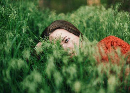 Beautiful woman resting in grass