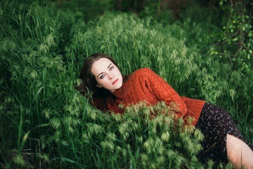 Unemotional woman chilling in meadow