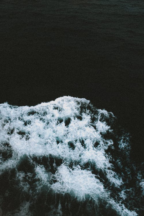 Ship wake in dark ocean