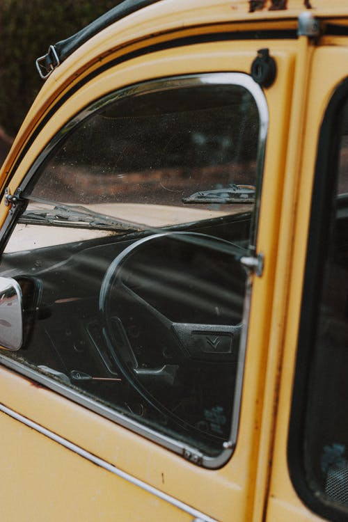 Steering wheel of yellow retro car