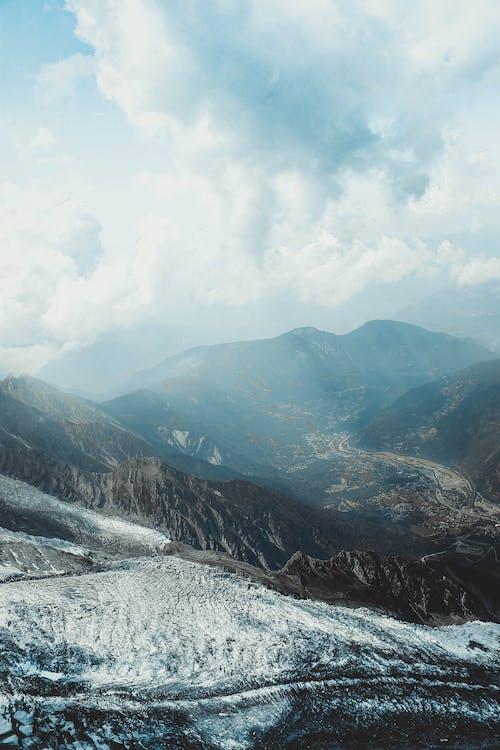Snowy mountainous landscape under peaceful sky