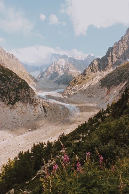 Amazing view of narrow curvy path leading through rough mountain ridge against blue sky