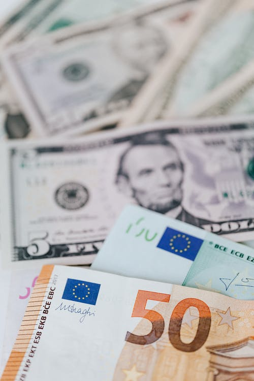 Cash money of dollar and euro banknotes