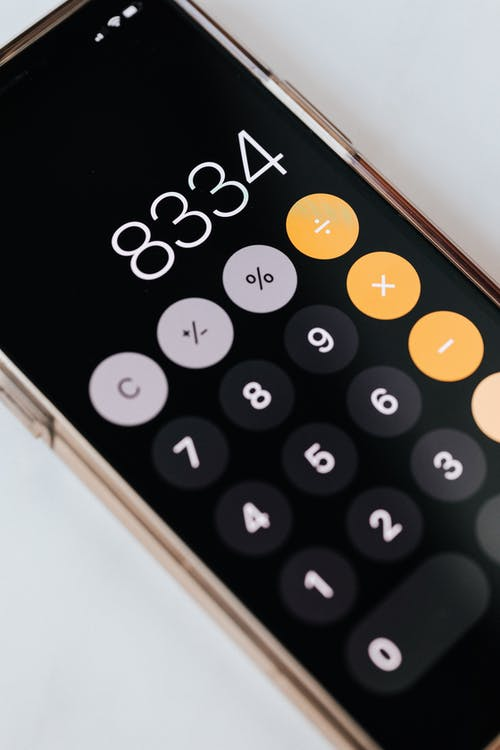 Smartphone with calculator app showing total amount