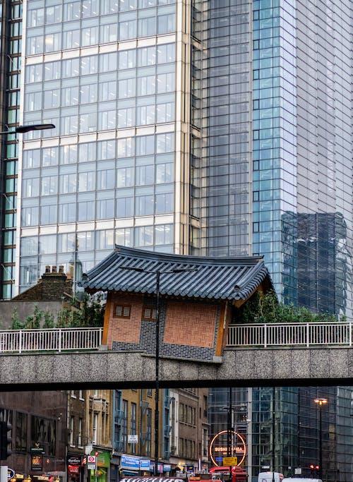 Korean house installed above bridge in modern city