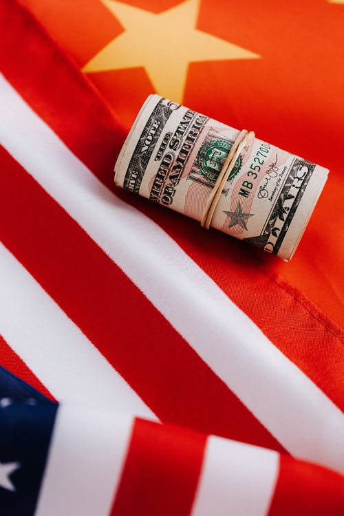 Bright American flag with roll of paper money
