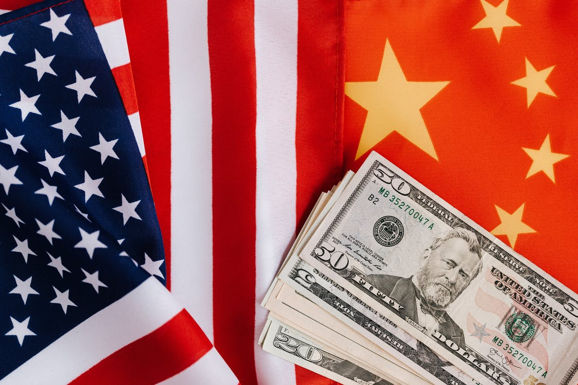American and Chinese flags and USA dollars