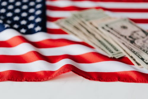 American dollars on national flag