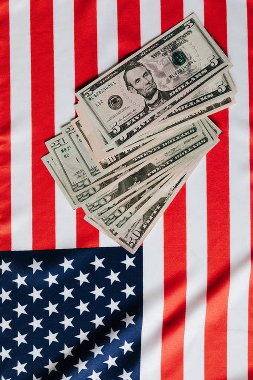American dollars placed on national flag