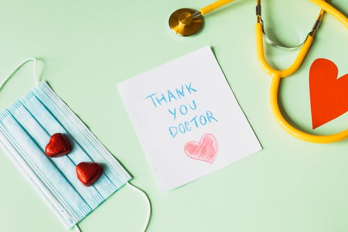 Thank you Doctors Note next to a Face Mask and a Stethoscope
