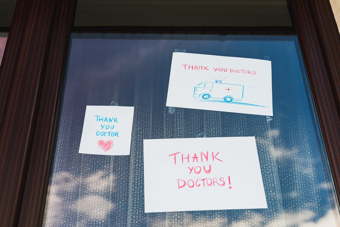 Notes Thanking Doctors Taped on a Window