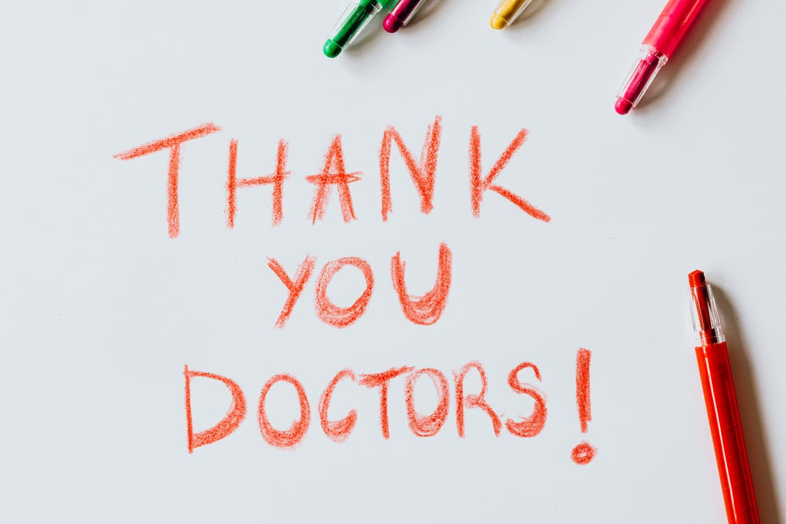 Thank You Doctors Written with red Colored Pencil