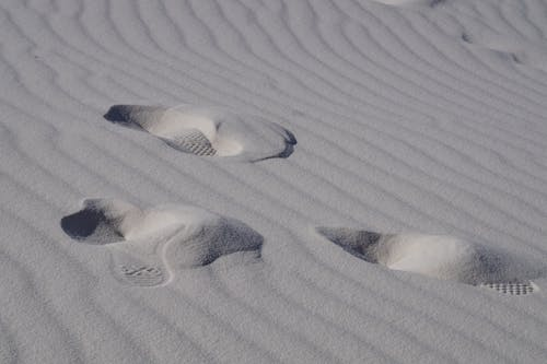 Free stock photo of footprints, sand, waves