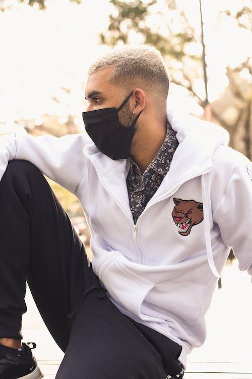 Photo of Man Wearing White Jacket and Black Pants