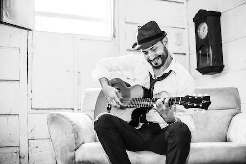 Man in Dress White Shirt Playing Acoustic Guitar