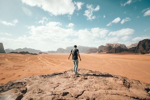 Traveler exploring rocky arid terrain during vacation