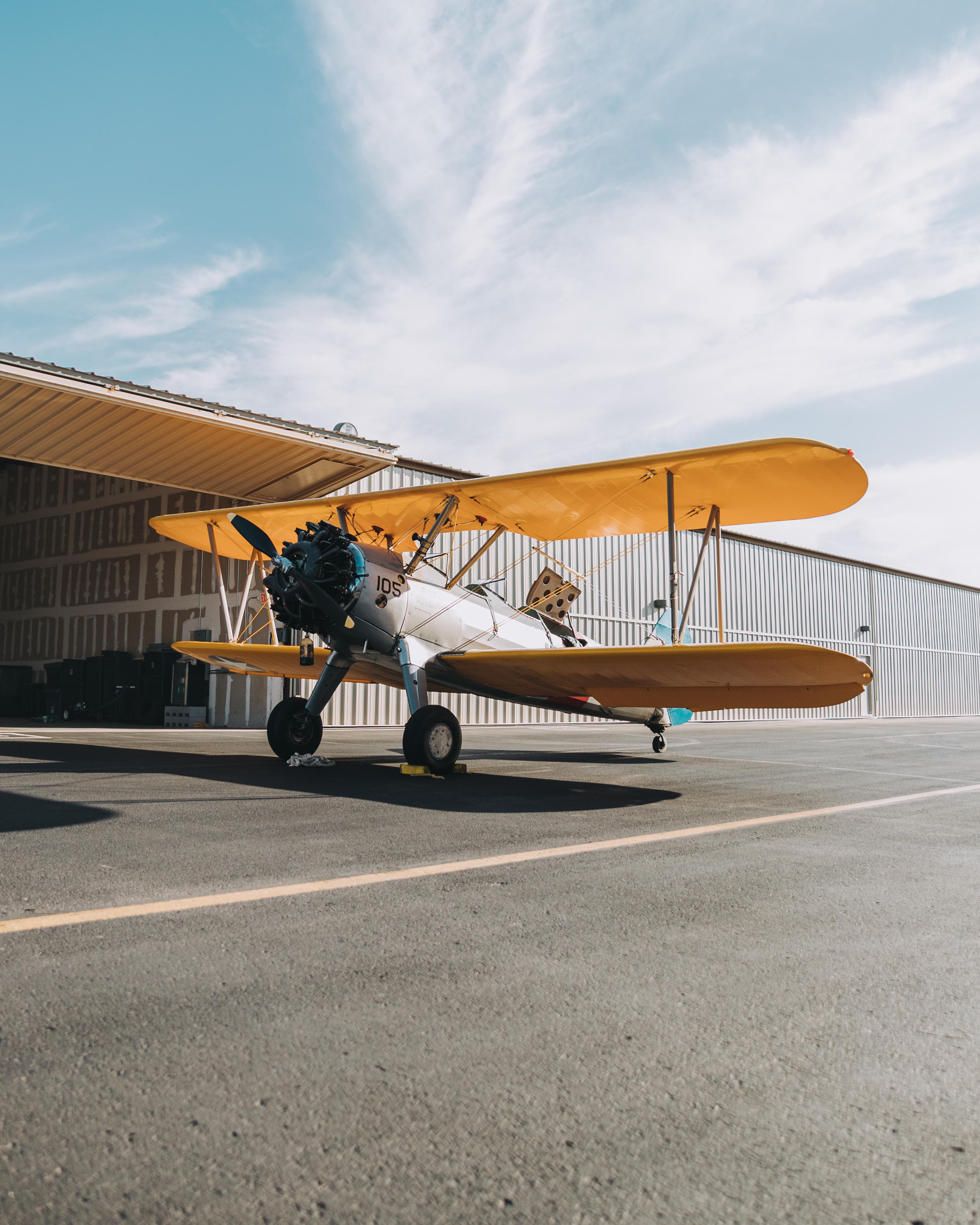 crop duster on runway in daytime