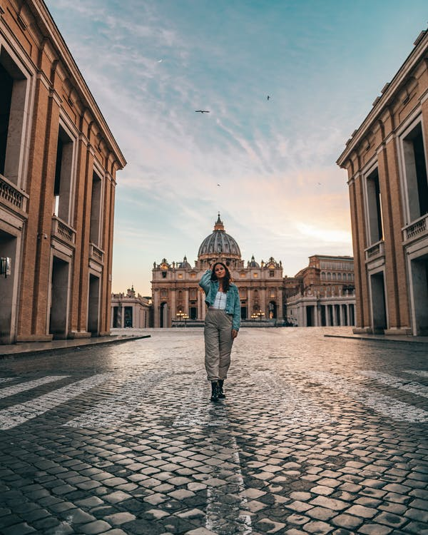 Full length of young female tourist standing against old historical Christian building  Cathedral of Saint Paul