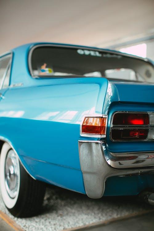 Blue Chevrolet Camaro on Road