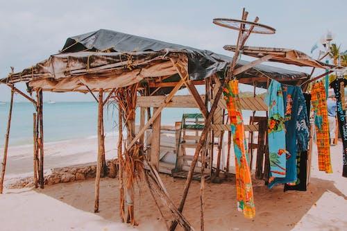 Old wooden construction on sandy sea beach