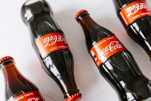 Bottles of soft coke drink on white background
