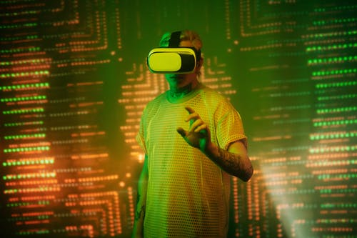 Man in Yellow and Black Checked Button Up Shirt Wearing White and Green Vr Goggles