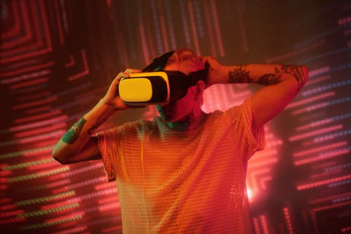 Man in White and Red Checked Shirt Wearing Black and White Vr Goggles