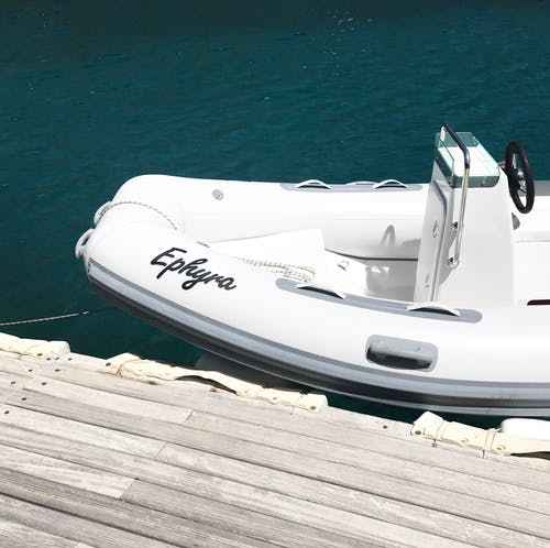 White Ephyra Center Console Boat on Body of Water