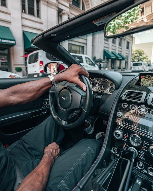 Man in Black T-shirt Driving Car
