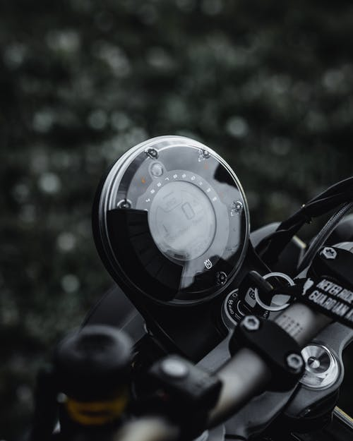 Black Motorcycle Speedometer in Close Up Photography