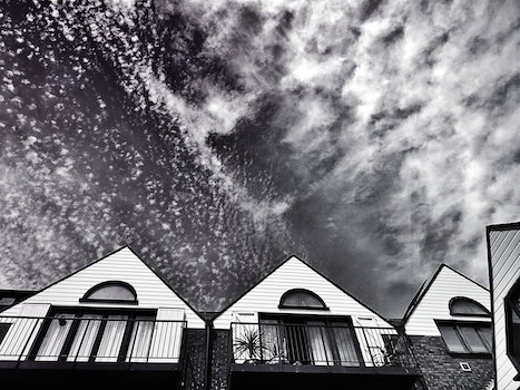 Free stock photo of black-and-white, sky, clouds, village