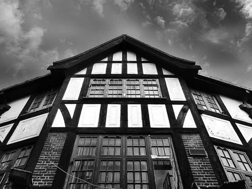 Low-angle Gray Scale Photography of Building