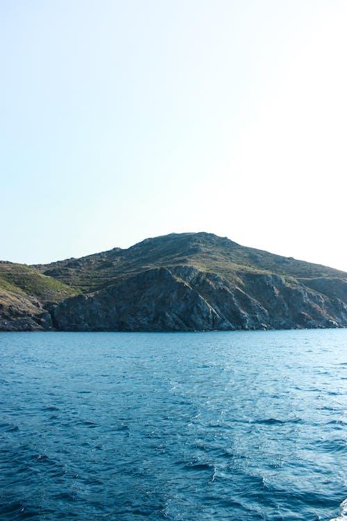 Rocky coast of vibrant reservoir