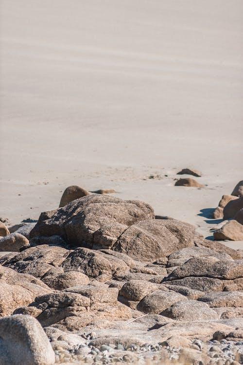 Large stones on coast of reservoir