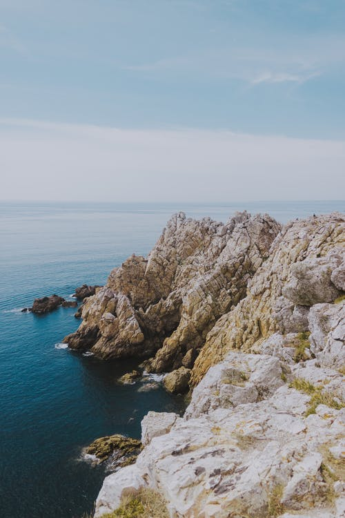 Rocky coast of vibrant ocean